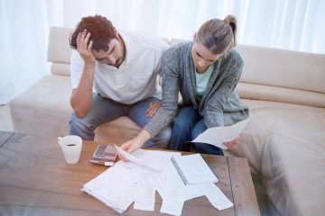Man and woman looking at bills. for debt troubles